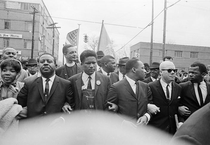 John Lewis, far right, with Martin Luther King Jr. and other civil rights leaders leading a march to Montgomery, Alabama, on March 17, 1965.