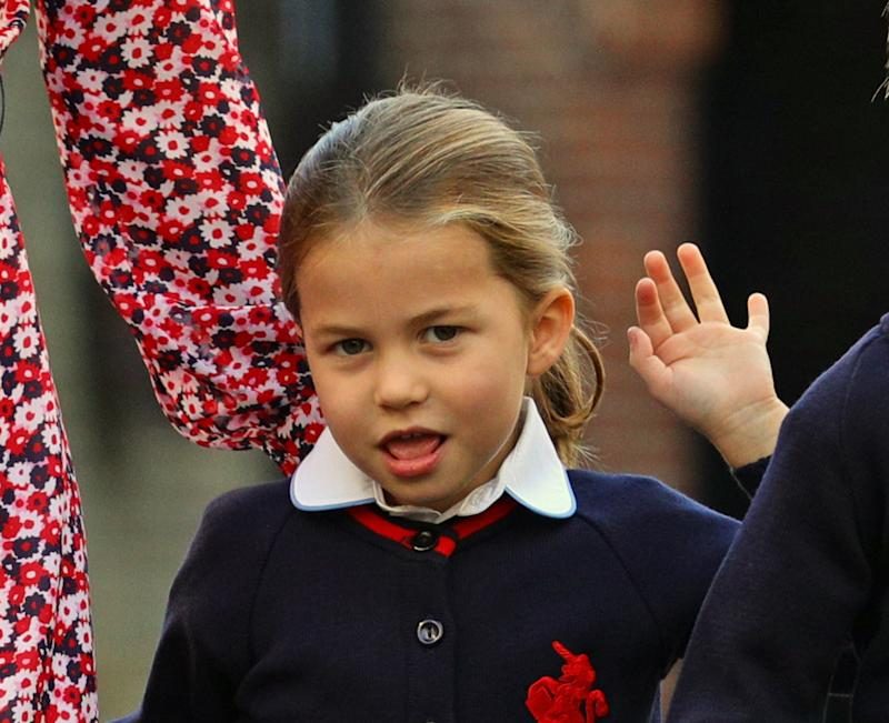 Britain's Princess Charlotte of Cambridge gestures as she arrives for her first day of school at Thomas's Battersea in London on September 5, 2019. (Photo by Aaron Chown / POOL / AFP) (Photo credit should read AARON CHOWN/AFP/Getty Images)