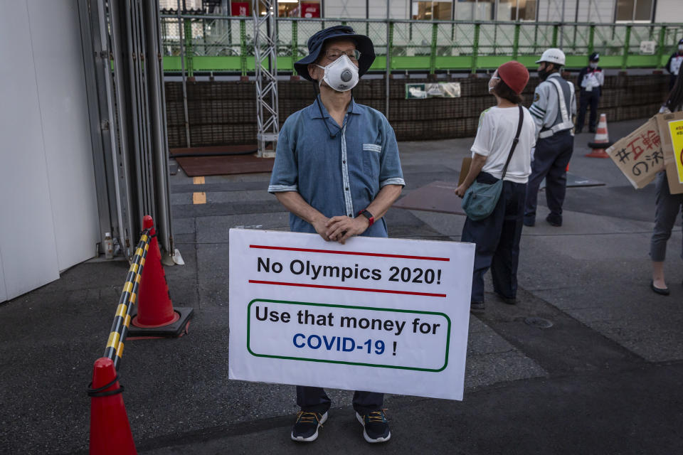 TOKYO, JAPAN - JULY 16: A man holds a placard during a demonstration against the forthcoming Tokyo Olympic Games on July 16, 2021 in Tokyo, Japan. Protesters gathered to demonstrate against International Olympic Committee President Thomas Bach's visit to Hiroshima amid concern over the safety of holding the Games during the global coronavirus pandemic. (Photo by Yuichi Yamazaki/Getty Images)