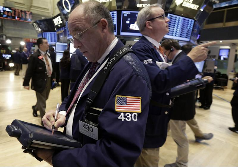 Traders Frederick Reimer, left, and David O'Day, right, work on the floor of the New York Stock Exchange Wednesday, Jan. 30, 2013. Stocks are falling after the government revealed that economic growth shrank in the final quarter of 2012. (AP Photo/Richard Drew)