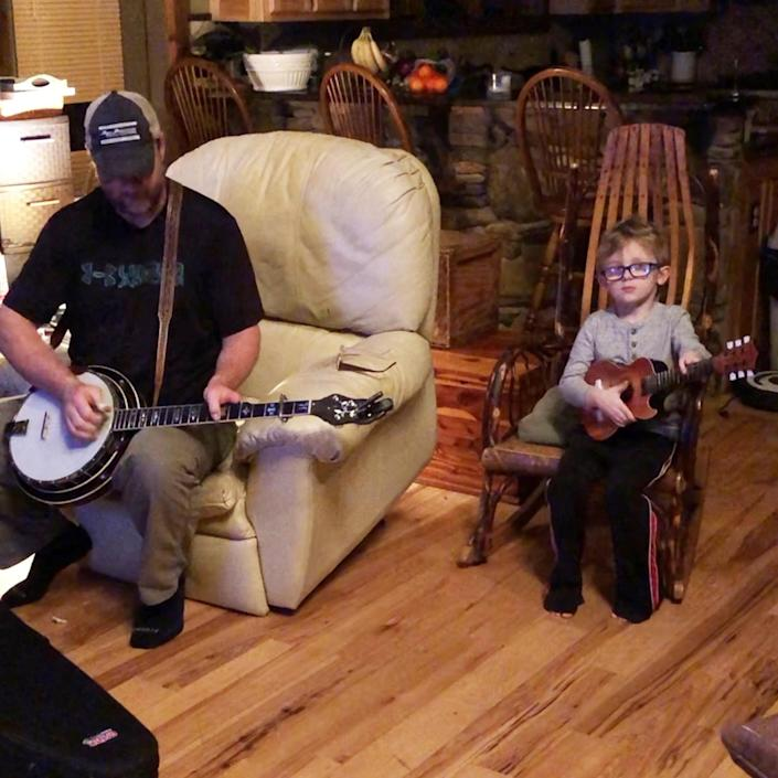 Tyler and Barry Abernathy practice playing music together. (Abernathy Family)