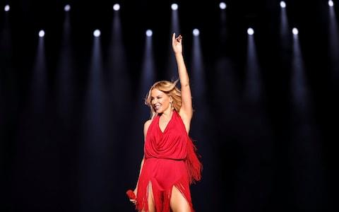 The pop singer Kylie Minogue on stage - Credit: Getty
