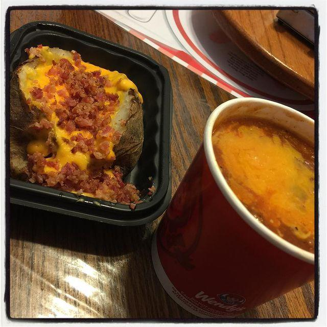 """<p><strong>What is it:</strong> Hot and fluffy potato topped with creamy cheese sauce, shredded cheese, and Applewood smoked bacon. Because nothing goes with a potato like cheese, more cheese, and also bacon.</p><p><strong>Why it's good tier: </strong>Yes, it's just a humble backed potato, but it does come with cheese and bacon.</p><p><a href=""""https://www.instagram.com/p/BLhC_voBOOQ/"""" rel=""""nofollow noopener"""" target=""""_blank"""" data-ylk=""""slk:See the original post on Instagram"""" class=""""link rapid-noclick-resp"""">See the original post on Instagram</a></p>"""