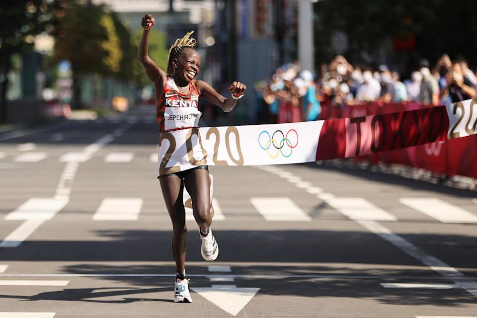 <p>Peres Jepchirchir of Team Kenya celebrates as she crosses the finish line to win the gold medal in the Women's Marathon Final. </p>