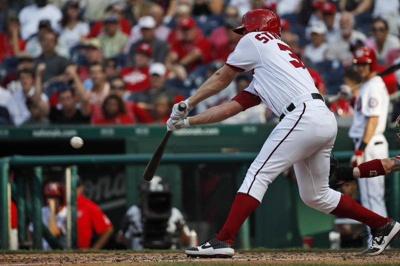 Washington Nationals' Stephen Strasburg hits an RBI single during the fifth inning of the team's baseball game against the Cincinnati Reds at Nationals Park, Wednesday, Aug. 14, 2019, in Washington. (AP Photo/Alex Brandon)