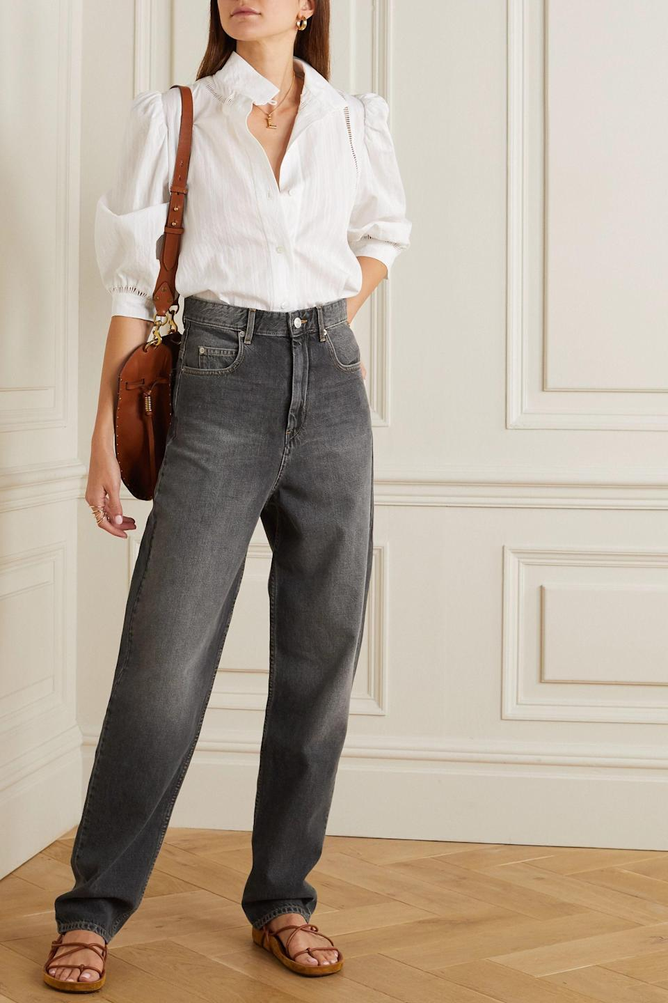 """<p><strong>ISABEL MARANT ÉTOILE</strong></p><p>net-a-porter.com</p><p><strong>$145.00</strong></p><p><a href=""""https://go.redirectingat.com?id=74968X1596630&url=https%3A%2F%2Fwww.net-a-porter.com%2Fen-us%2Fshop%2Fproduct%2Fisabel-marant-etoile%2Fclothing%2Fstraight-leg%2Fcorsy-high-rise-tapered-jeans%2F24092600056996705&sref=https%3A%2F%2Fwww.cosmopolitan.com%2Fstyle-beauty%2Ffashion%2Fg36618322%2Fnet-a-porter-spring-sale-2021%2F"""" rel=""""nofollow noopener"""" target=""""_blank"""" data-ylk=""""slk:Shop Now"""" class=""""link rapid-noclick-resp"""">Shop Now</a></p><p>Something that's impossible to own too many of: a dark wash jean.</p>"""