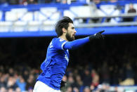 Everton's Andre Gomes celebrates scoring his side's first goal of the game, during the English Premier League soccer match between Everton and Wolverhampton Wanderers at Goodison Park, in Liverpool, England, Saturday, Feb. 2, 2019. (Peter Byrne/PA via AP)