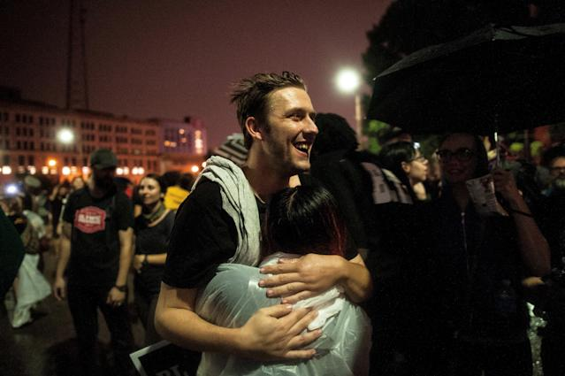 Mike Price, a 24-year-old arrested Sunday, hugs a friend as he walks out of the St. Louis City Justice Center after his releaseMonday. (Joseph Rushmore for HuffPost)