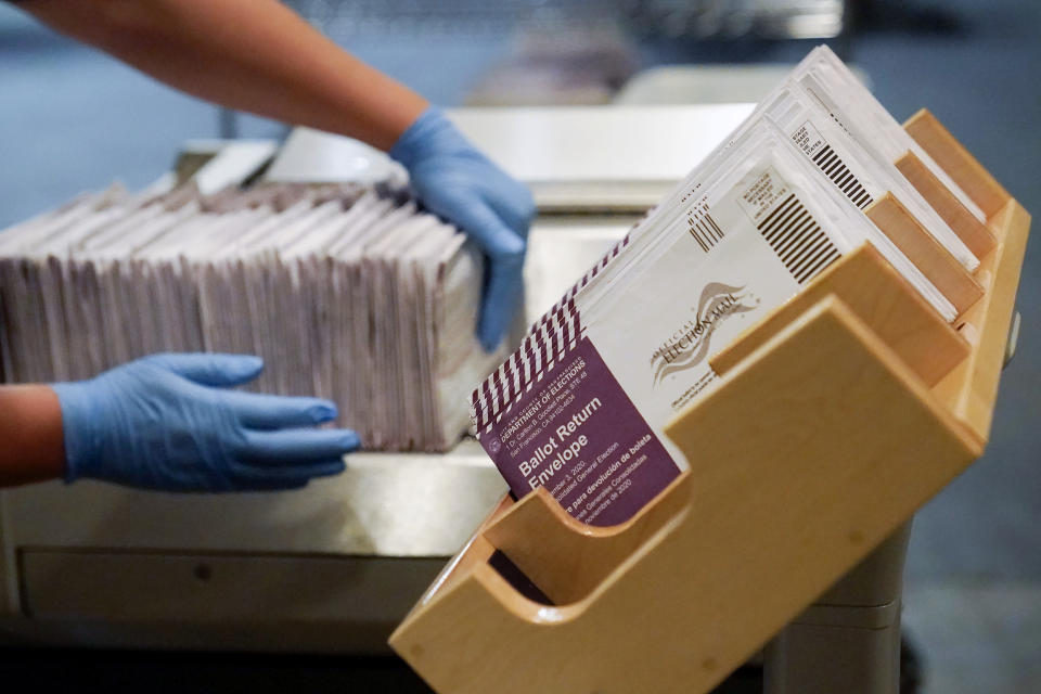 FILE - In this Nov. 1, 2020, file photo, envelopes containing ballots are shown at a San Francisco Department of Elections at a voting center in San Francisco. A new study finds the expansion of mail voting did not benefit Democrats or increase turnout. (AP Photo/Jeff Chiu, File)