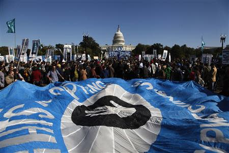 "Demonstrators hold a parachute as they protest during the ""Stop Watching Us: A Rally Against Mass Surveillance"" near the U.S. Capitol in Washington, October 26, 2013. REUTERS/Jonathan Ernst"