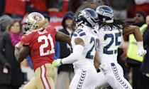 San Francisco 49ers running back Frank Gore, left, carries the ball on a 51-yard run as Seattle Seahawks free safety Earl Thomas (29) and cornerback Richard Sherman (25) look on in the fourth quarter of an NFL football game, Sunday, Dec. 8, 2013, in San Francisco. The 49ers defeated the Seahawks 19-17. (AP Photo/Ben Margot)