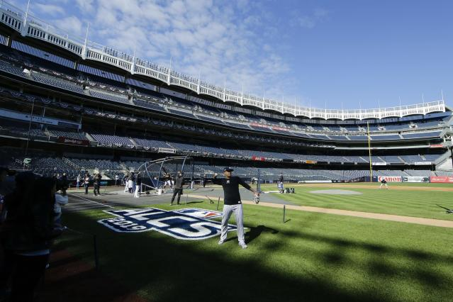 New York Yankees' Gio Urshela throws a baseball during a team practice at Yankee Stadium Thursday, Oct. 10, 2019, New York. The Yankees will play the winner of tonight's Tampa Bay Rays at Houston Astros American League Division Series game in Game 1 of the American League Championship Series on Saturday, Oct. 12 in New York. (AP Photo/Frank Franklin II)
