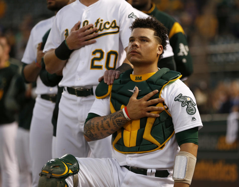 Oakland Athletics' Bruce Maxwell (13) kneels next to Oakland Athletics' Mark Canha (20) during the National Anthem before their game against the Seattle Mariners at the Coliseum in Oakland, Calif., on Monday, September 25, 2017. (Nhat V. Meyer/Bay Area News Group) (Photo by MediaNews Group/Bay Area News via Getty Images)