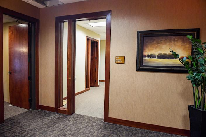 """At one Sioux Falls address listed for Reagan National University, a plaque reads """"Si Tanka University."""" Reagan's operators changed the university's name from Si Tanka to Reagan in 2017. The suite was nearly empty on Jan. 29."""