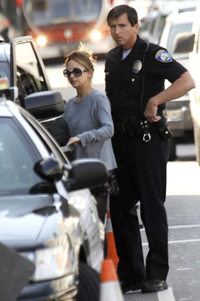 """Just like Jon and Kate, Nicole Richie is constantly followed by the paparazzi. On Monday, one photographer got a little too close and ran into the back of her car in Beverly Hills. London Entertainment/<a href=""""http://www.splashnewsonline.com"""" target=""""new"""">Splash News</a> - October 5, 2009"""