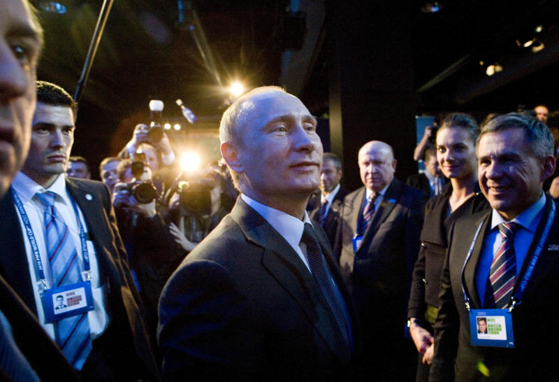Russian President Vladimir Putin, center, greets the Russian delegation after arriving for a press conference directly from Moscow after Russia was announced being the host for the 2018 soccer World Cup in Zurich, Switzerland, Thursday, Dec. 2, 2010. (AP Photo/Anja Niedringhaus)