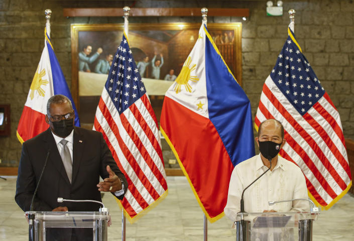 United States Defense Secretary Lloyd Austin, left, and Philippines Defense Secretary Delfin Lorenzana hold a press conference after a bilateral meeting at Camp Aguinaldo military camp in Quezon City, Metro Manila, Philippines Friday, July 30, 2021. Austin is visiting Manila to hold talks with Philippine officials to boost defense ties and possibly discuss the The Visiting Forces Agreement between the US and Philippines. (Rolex dela Pena/Pool Photo via AP)