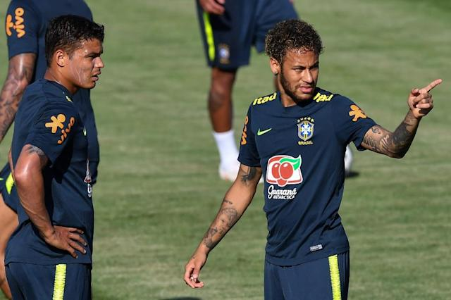 Neymar talks with Thiago Silva, his close friend and PSG teammate, at Brazil training in Sochi (AFP Photo/NELSON ALMEIDA)