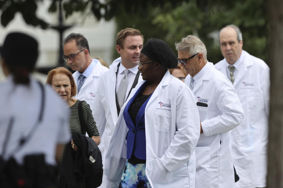 Members of the American Frontline Doctors seen while at Capitol Hill after giving a press conference addressing COVID-19 misinformation in Washington D.C. on July 27, 2020. (Credit: mpi34/MediaPunch/IPX via AP)