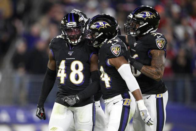 Baltimore Ravens linebacker Patrick Onwuasor (48) is congratulated by cornerback Marlon Humphrey (44) and safety Chuck Clark (36) after recording a sack on New England Patriots quarterback Tom Brady during the first half of an NFL football game, Sunday, Nov. 3, 2019, in Baltimore. (AP Photo/Nick Wass)