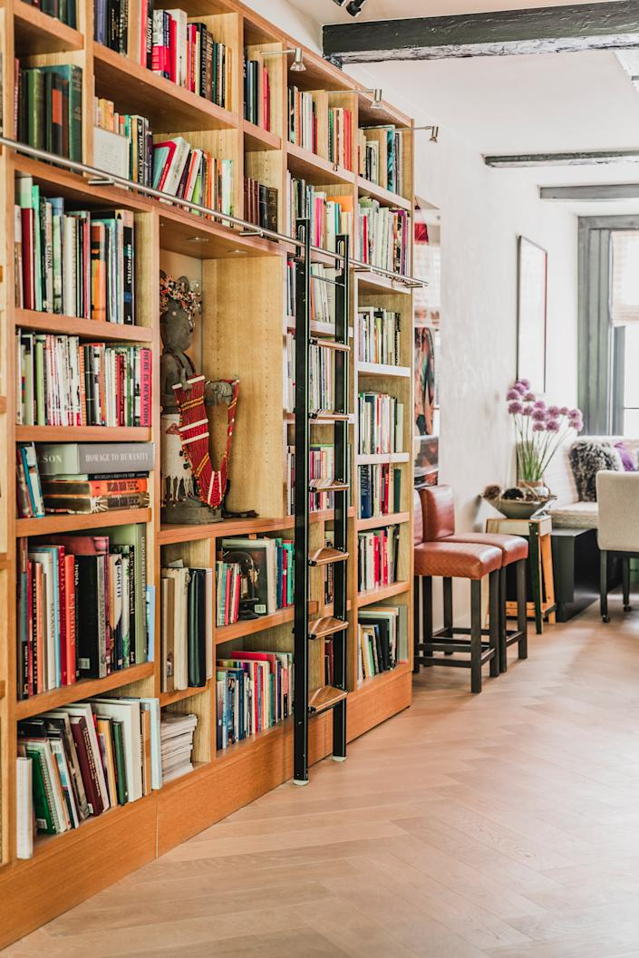 "<div class=""caption""> ""Nowadays you find many projects without bookcases, but I believe you can know a person by the books they read,"" she says. The two leather barstools are by <a href=""https://www.mariescorner.com/"" rel=""nofollow noopener"" target=""_blank"" data-ylk=""slk:Marie's Corner"" class=""link rapid-noclick-resp"">Marie's Corner</a> and the wooden stool by <a href=""https://www.thefutureperfect.com/made-by/designer/piet-hein-eek/"" rel=""nofollow noopener"" target=""_blank"" data-ylk=""slk:Piet Hein Eek"" class=""link rapid-noclick-resp"">Piet Hein Eek</a>. </div>"