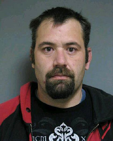 This booking photo released by Vermont State Police shows Ricky Benjamin, 35, of Alburgh, Vt. Authorities said four suspects, including Benjamin, stole items including more than $200,000 in gold coins from a vacant home in Alburgh after its eccentric owner died in a farm accident last year. Benjamin, Shawn Farrell, 41, and Mark Mumley, 52, were arraigned and held on $75,000 bail. A fourth suspect, Jennifer Jarvis, 32, was released after being issued a citation. (AP Photo/Vermont State Police)