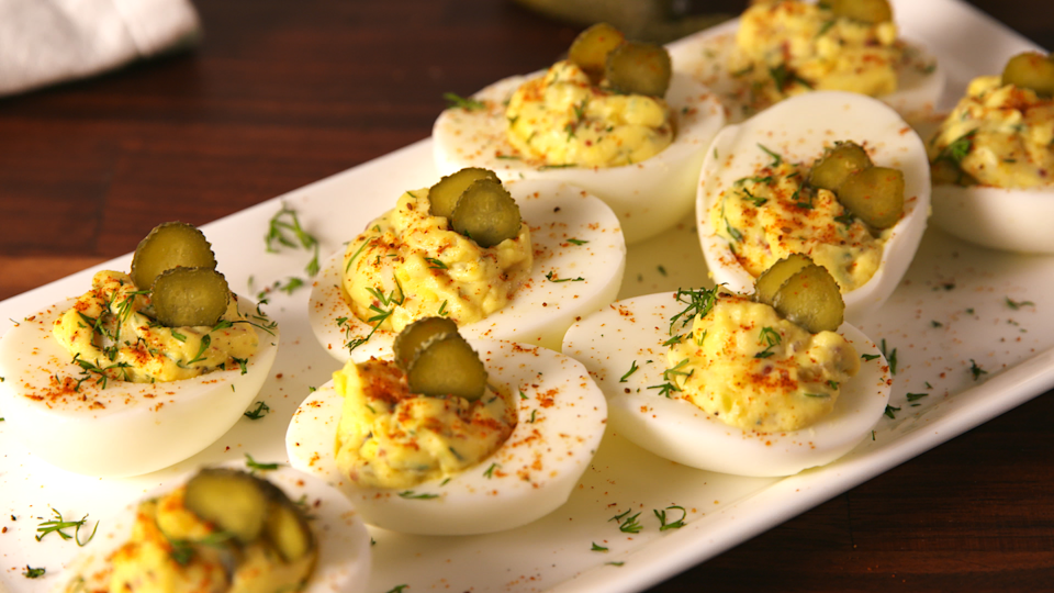 """<p>Pickles and deviled eggs are two classic snacks. So why not combine them into the ultimate bite?</p><p><strong><em>Get the recipe at <a href=""""https://www.delish.com/cooking/recipe-ideas/recipes/a56422/dill-pickle-deviled-eggs-recipe/"""" rel=""""nofollow noopener"""" target=""""_blank"""" data-ylk=""""slk:Delish"""" class=""""link rapid-noclick-resp"""">Delish</a>.</em></strong></p>"""