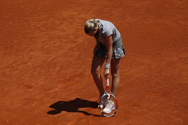 Petra Kvitova from Czech Republic reacts during a Madrid Open tennis tournament match against Simona Halep from Romania in Madrid, Spain, Saturday, May 10, 2014 . (AP Photo/Daniel Ochoa de Olza)