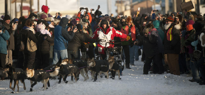 Dallas Seavey reaches the finish line to claim victory in the Iditarod Trail Sled Dog Race in Nome, Alaska, on Tuesday, March 13, 2012. Seavey is the youngest musher to win the nearly 1,000-mile race across Alaska. (AP Photo/Marc Lester, Anchorage Daily News)