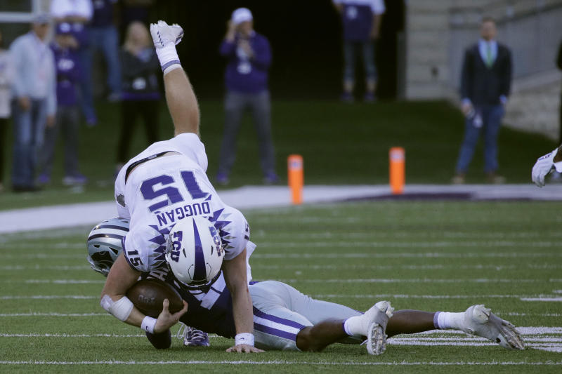 TCU quarterback Max Duggan (15) is tackled by Kansas State defensive back AJ Parker (12) during the second half of an NCAA college football game Saturday, Oct. 19, 2019, in Manhattan, Kan. Kansas State won 24-17. (AP Photo/Charlie Riedel)