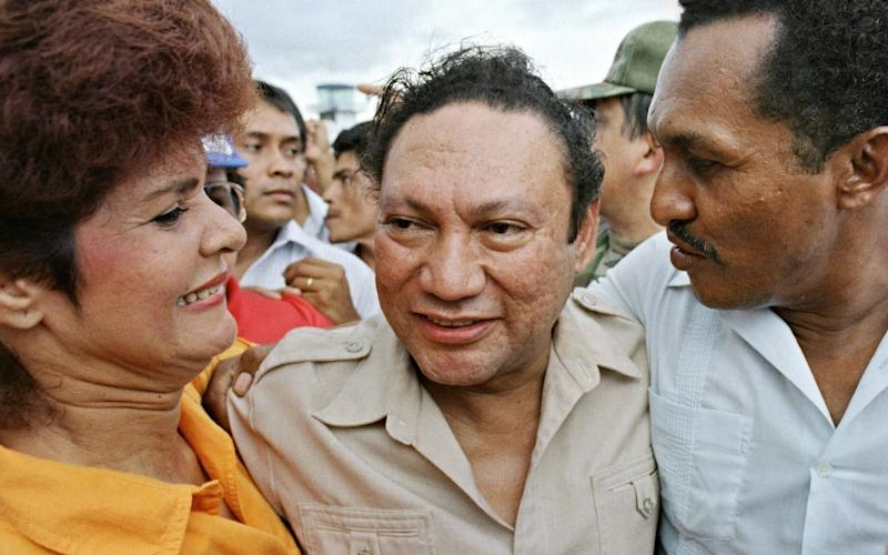General Manuel Noriega, surrounded by his supporters at the height of his power in 1987 - Credit: AFP