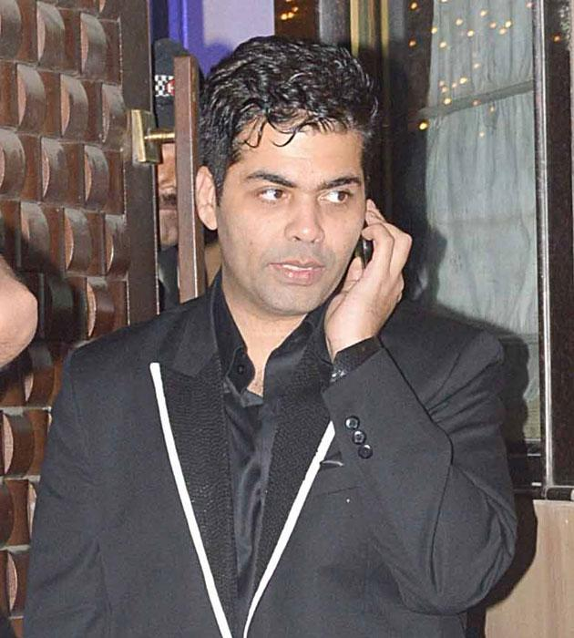 Karan Johar arrives for the bash