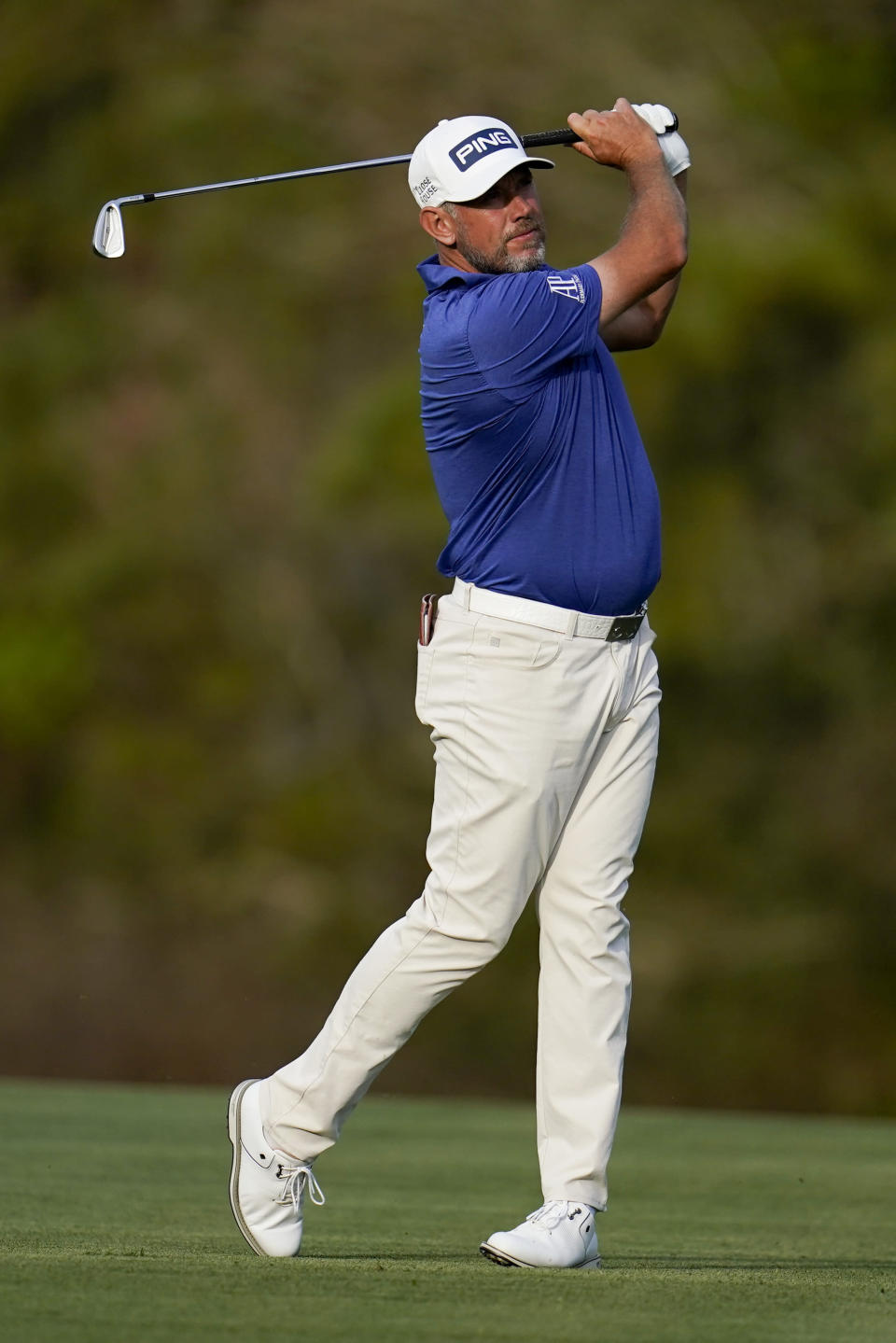 Lee Westwood, of England, hits from the fairway on the 14th hole during the third round of The Players Championship golf tournament Saturday, March 13, 2021, in Ponte Vedra Beach, Fla. (AP Photo/Gerald Herbert)