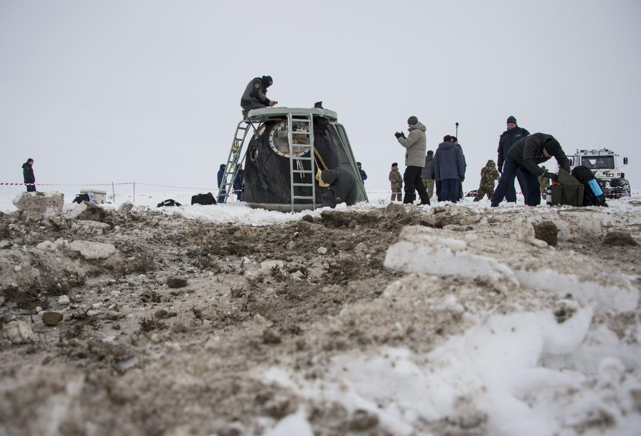 The Soyuz TMA-10M capsule is seen shortly after it landed with former ISS commander Oleg Kotov and flight engineers Sergei Ryazansky and Michael Hopkins from NASA onboard in a remote area southeast of the town of Zhezkazgan in central Kazakhstan, March 11, 2014. An American astronaut and two Russians who carried a Sochi Olympic torch into open space landed safely and on time on Tuesday in Kazakhstan, defying bad weather and ending their 166-day mission aboard the International Space Station (ISS). Inside the capsule were former ISS commander Oleg Kotov and flight engineers Sergei Ryazansky and Michael Hopkins from NASA. The trio launched together into space on September 25. REUTERS/Bill Ingalls/NASA/Handout via Reuters (KAZAKHSTAN - Tags: TRANSPORT SPORT OLYMPICS SCIENCE TECHNOLOGY) 