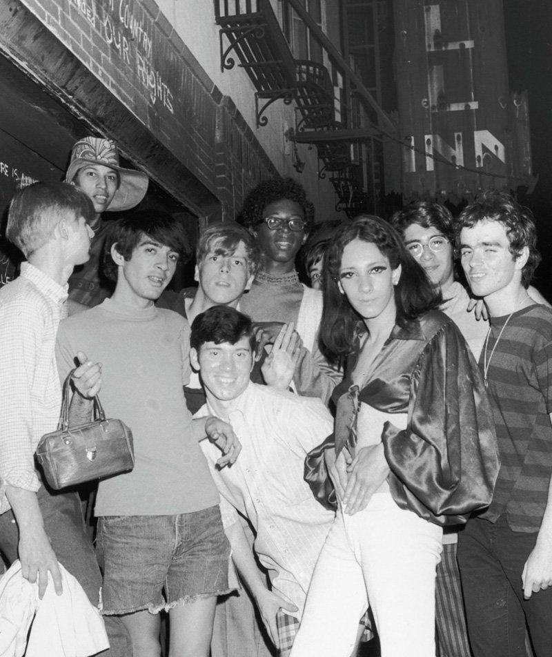 <p>A group photo outside of the Stonewall Inn, circa 1968. The famous West Village establishment was purchased by Mafia members in 1966, and quickly gained popularity among the gay community  as one of the few establishments that permitted same sex dancing. </p>