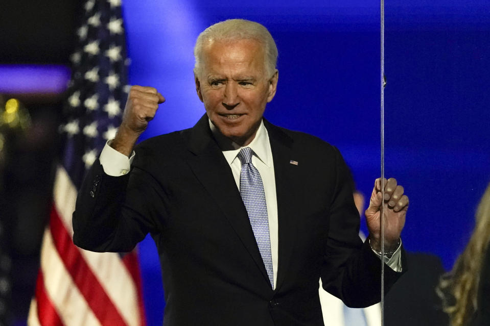 President-elect Joe Biden gestures to supporters Saturday, Nov. 7, 2020, in Wilmington, Del. (AP Photo/Andrew Harnik)