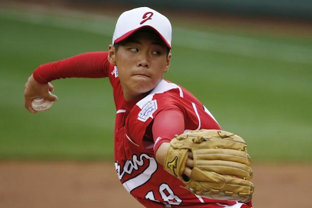 CORRECTS DATE AND YEAR TO AUG. 20, 2014 - Tokyo pitcher Takuma Takahashi delivers in the first inning of a International semi-final baseball game against Seoul at the Little League World Series tournament in South Williamsport, Pa., Wednesday, Aug. 20, 2014. (AP Photo/Gene J. Puskar)