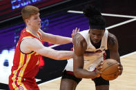 Miami Heat forward Precious Achiuwa, right, is defended by Atlanta Hawks guard Kevin Huerter during the first half of an NBA basketball game Tuesday, March 2, 2021, in Miami. (AP Photo/Wilfredo Lee)