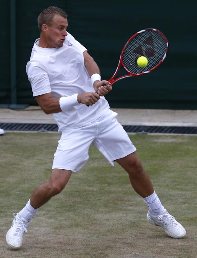 Lleyton Hewitt of Australia plays a return to Jerzy Janowicz of Poland during their men's singles match at the All England Lawn Tennis Championships in Wimbledon, London, Thursday, June 26, 2014. (AP Photo/Sang Tan)