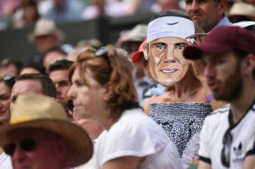 Who are you? A spectator wears a mask of Rafael Nadal