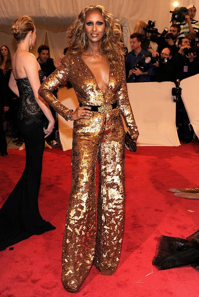 "Whoa! Iman certainly stood out in her gold sequined Stella McCartney jumpsuit featuring a plunging neckline. She's one of the few people who could pull this look off! Kevin Mazur/<a href=""http://www.gettyimages.com/"" target=""new"">GettyImages.com</a> - May 2, 2011"