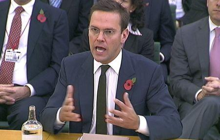 File photograph shows News International Chairman James Murdoch speaking to parliamentarians in London