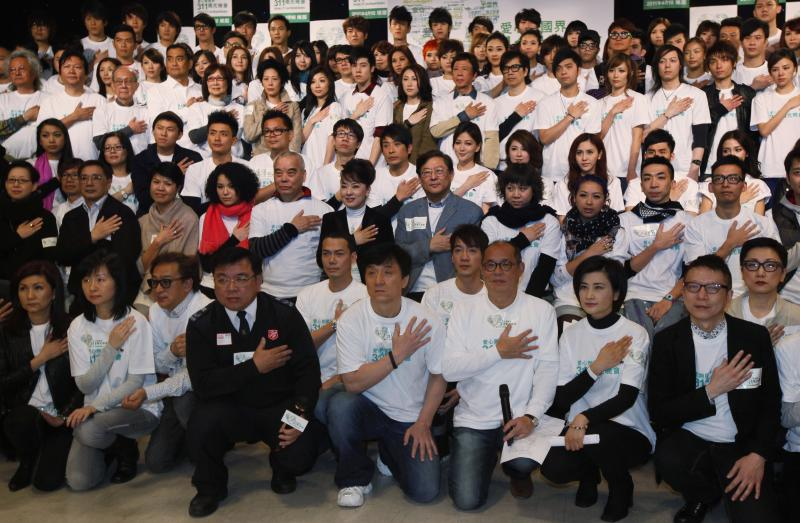 Hong Kong actor Jackie Chan, front center, and other artists pose before a news conference for an upcoming charity event for the victims and survivors of the March 11 earthquake and tsunami in Japan, in Hong Kong Thursday, March 24, 2011. The Hong Kong entertainment industry will organize the charity event to pay respects to the deceased, send condolences and love to those who lost loved ones and encourage the survivors of the disaster.  (AP Photo/Kin Cheung)