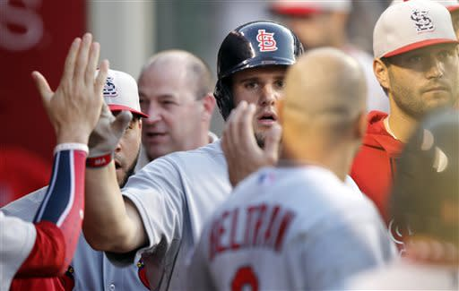 St. Louis Cardinals' Matt Adams, center, is congratulated by teammates after scoring against the Los Angeles Angels in the sixth inning during a baseball game on Thursday, July 4, 2013, in Anaheim, Calif. (AP Photo/Alex Gallardo)