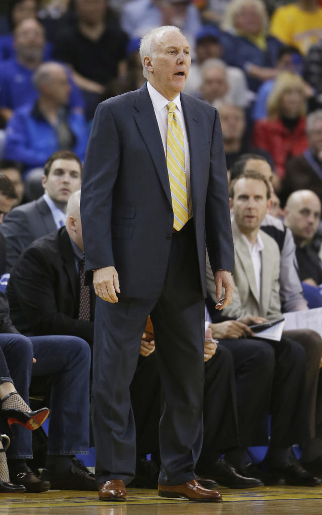 San Antonio Spurs coach Gregg Popovich watches from the bench during the first quarter of an NBA basketball game against the Golden State Warriors on Saturday, March 22, 2014, in Oakland, Calif. (AP Photo/Eric Risberg)