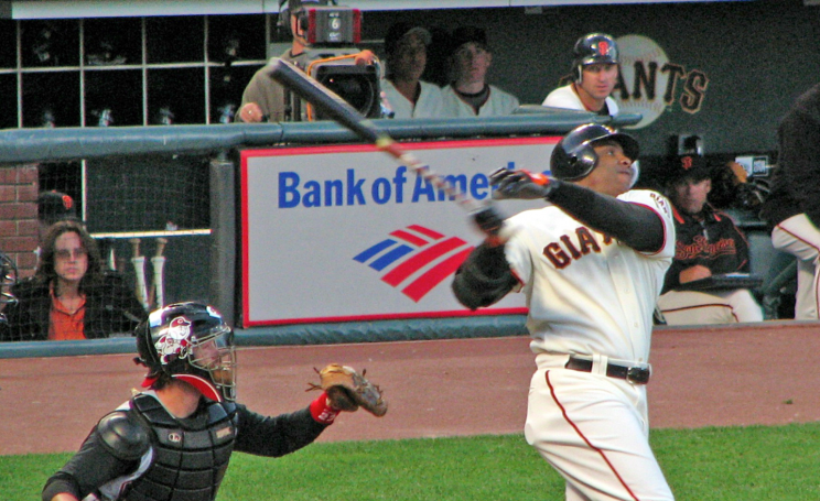 Barry Bonds hits a home run in front of a Bank of America sign.