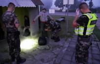 Lithuanian border guards detain migrants illegally crossing the border from Belarus to Lithuania, in Kalviai