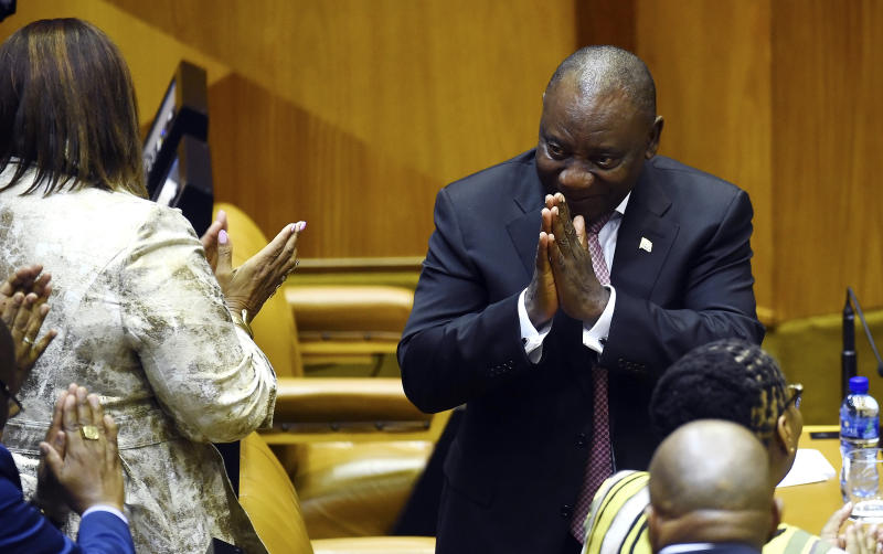 South Africa President Cyril Ramaphosa acknowledges members of parliament in Cape Town, South Africa, Wednesday, May 22, 2019. Ramaphosa has taken steps to crack down on corruption Wednesday as the country's new parliament voted him to lead the country for a five-year term. (AP Photo)