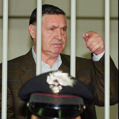 """In this April 29, 1993 file photo, Mafia """"boss of bosses"""" Salvatore """"Toto"""" Riina, is seen behind bars, during a trial in Rome. - Credit: AP"""