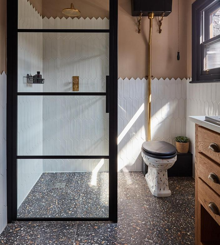 AFTER: By borrowing space from the adjoining bedroom, the couple extended the bathroom and installed an additional window to brighten it up. The toilet bowl, emblazoned with Chris's own graphic designs, is from The Remarkable Toilet Co.